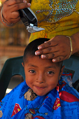 Child getting a haircut in Atencingo.