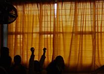 Students in a darkened classroom in Atencingo, Mexico.