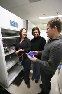 Research associate Caroline Smith, Dr. Imara Perera and senior Eric Land demonstrate prototypes of the equipment that will be used for remote-controlled research.