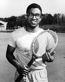 Irwin Holmes with tennis racquet