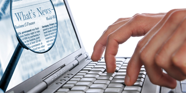 Hands typing on a laptop computer with a magnified version of the screen with the words what's new highlighted.