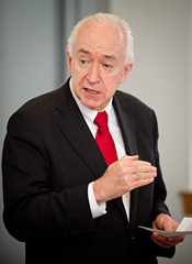 Jim McLay lectures a class in international affairs.