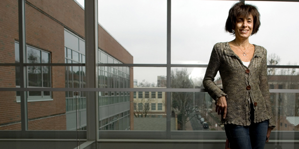 Marie Davidian at window of SAS Hall.