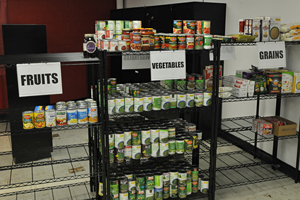 Food pantry with items on shelves.