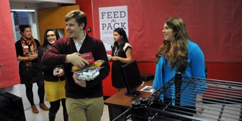 Students bring donations of food to the new food pantry.