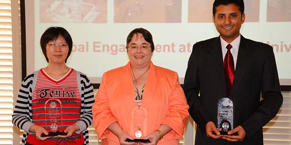 Three winners with awards.