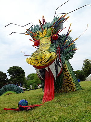 Dragon's head rising from grass.