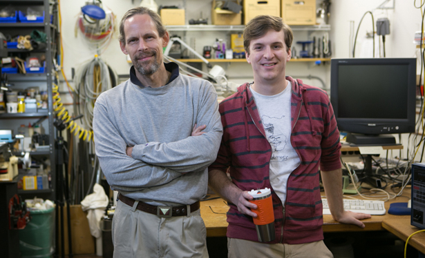 Dean Verhoeven (left) and Logan Maxwell (right). Maxwell began tinkering with ideas for the Temperfect mug (in his hand) as an undergrad at NC State.