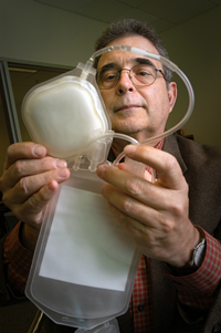Dr. Reuben Carbonell and his blood filter unit.