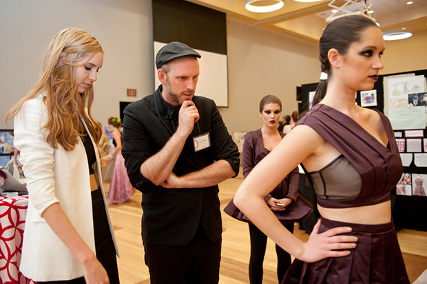Student designer Sarah Cannon (left) and faculty advisor Justin LeBlanc (center) inspect a dress at Art2Wear.