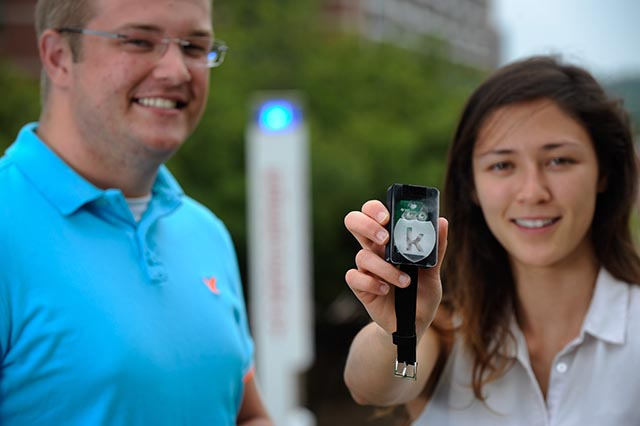 Student Bradford Ingersoll (left) and recent grad Tia Simpson (right) show off the Konnect, a one-button emergency notification system they built.