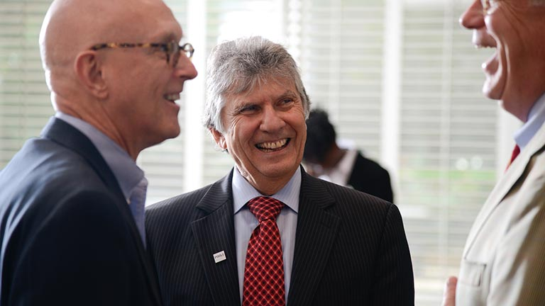 Poole College of Management Dean Ira Weiss (center) holds the first endowed deanship in NCState history.