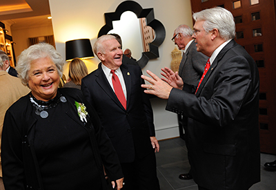 Chancellor Randy Woodson, left, meets with donors Bill and Marsha Prestage at the chancellor's residence.