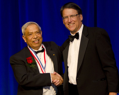 Jay Narayan (at left) and Governor Pat McCrory at the North Carolina Award ceremony Nov. 13.