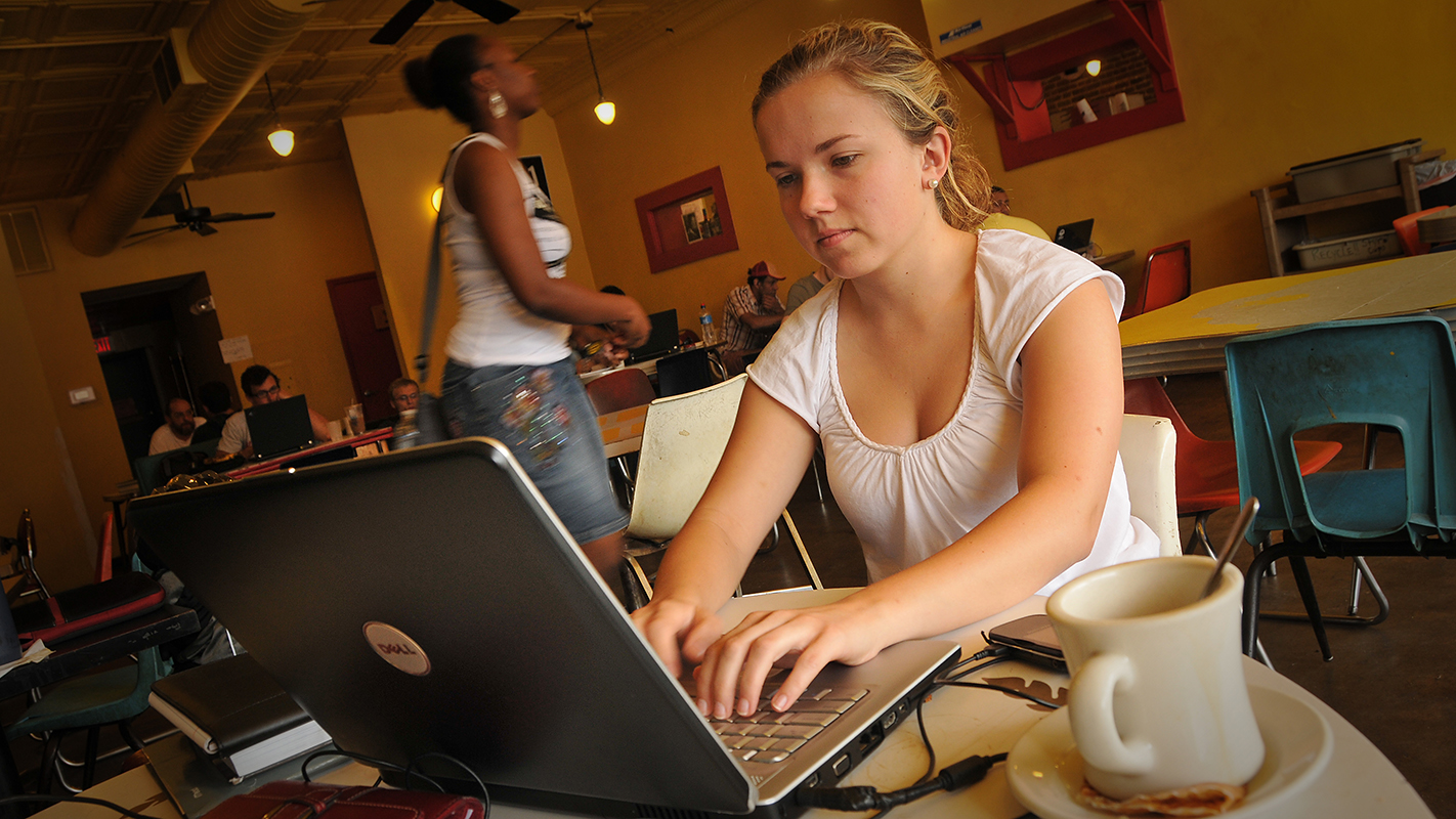 Student studies for an exam at Cup-a-Joe's on Hillsborough Street.