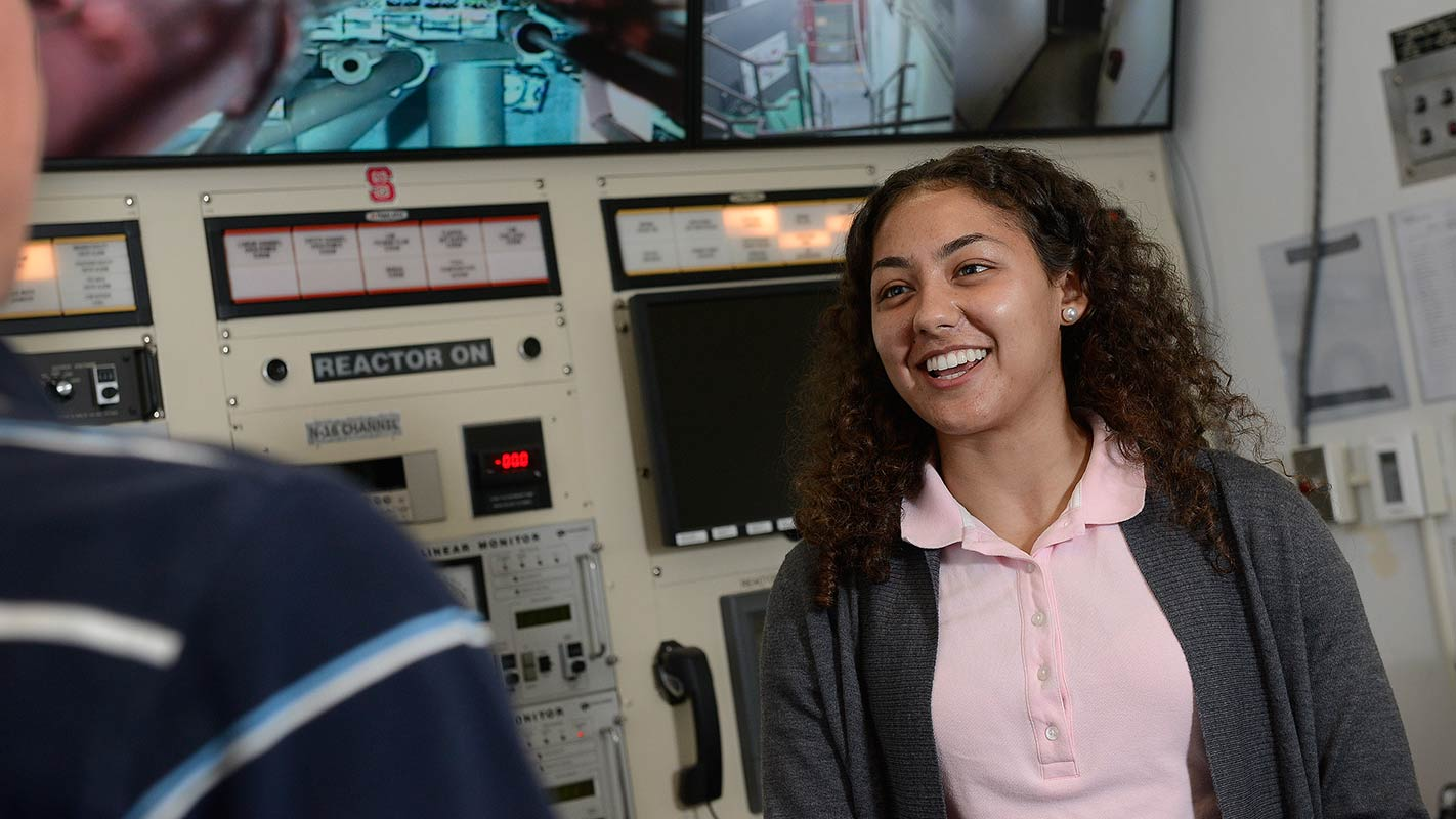 Jasmin Alsaied, a sophomore nuclear engineering student, works in the nuclear reactor at Burlington Labs.
