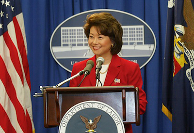 As Secretary of Labor, Chao announces the resolution of the West Coast Ports dispute.