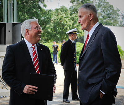 Gen. Hugh Shelton, former Chairman of the Joint Chiefs of Staff, talks with Chancellor Randy Woodson, left, at a campus event.