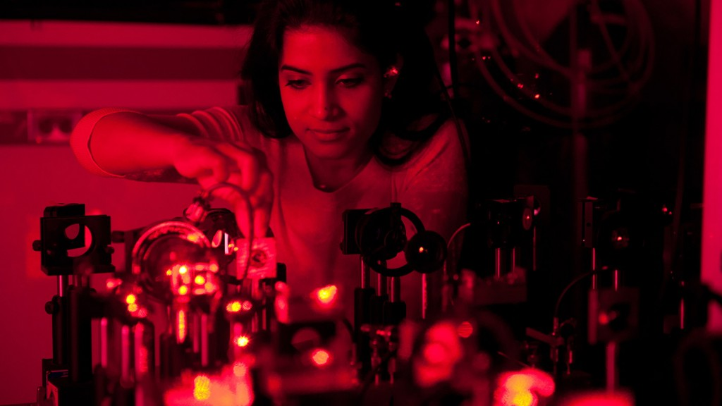 An NC State student is lit red as she works in the JET lab.