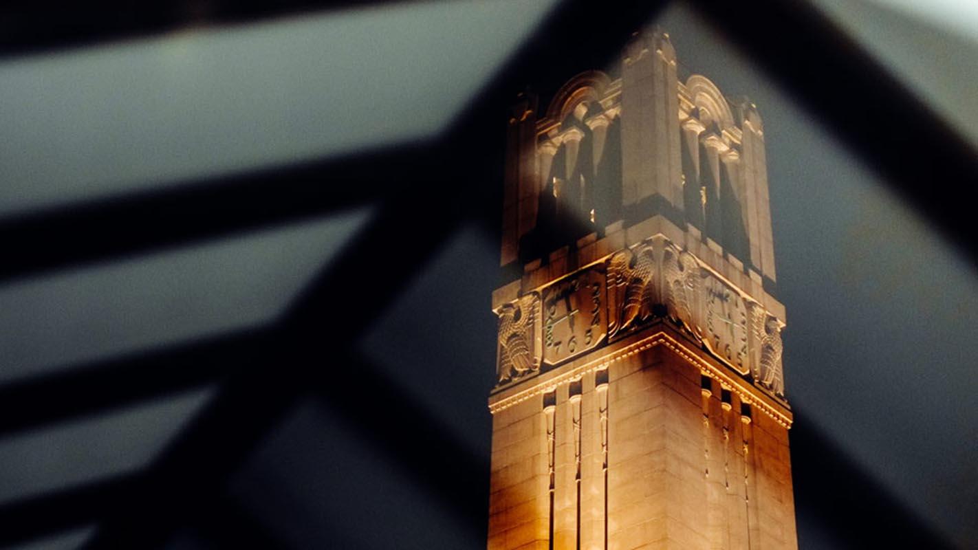 The Memorial Belltower, as viewed from a bus stop on Hillsborough Street.