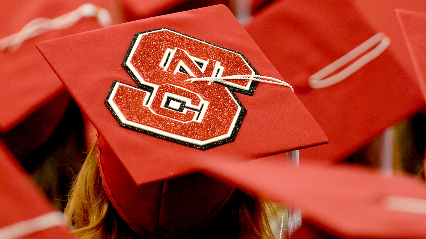 red mortarboard with block S logo