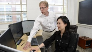 Fred Wright (left), director of the Bioinformatics Research Center and Yi-Hui Zhou, research associate professor of biological sciences, apply big-data methods to human health problems.