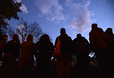 An evening vigil on the Brickyard caps an emotional and wrenching week for the Wolfpack family.