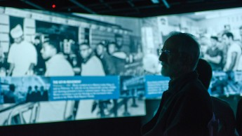 An audience member takes in details of the virtual MLK project at NC State's Hunt Library.