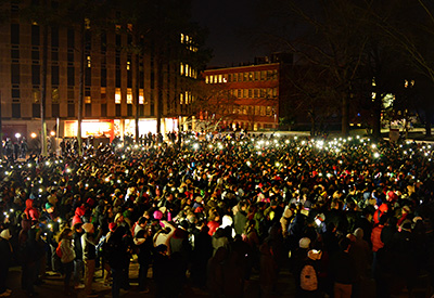 More than 3,000 people turn out against a bitter wind to honor three slain students.