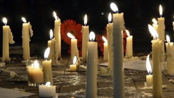 Candles at a vigil for shooting victims in Chapel Hill.