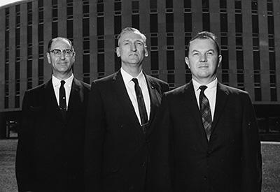 Professor William Block, right, with unidentified faculty senators on the Brickyard in the 1960s.