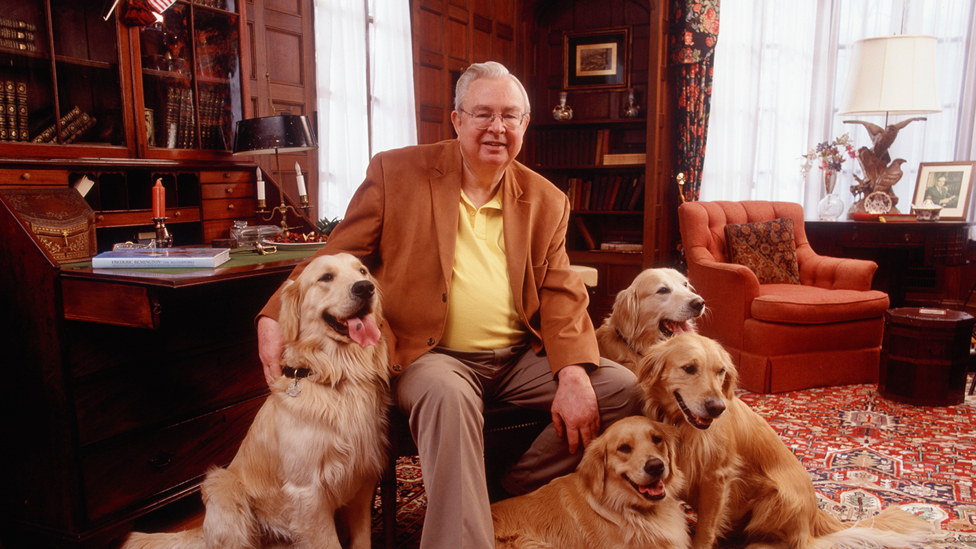 A portrait of the late Randall B. Terry, Jr., surrounded by his cherished golden retrievers.