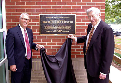 Chancellor Randy Woodson, left, and former Chancellor Poulton at the dedication of the Poulton Innovation Center on Centennial Campus.