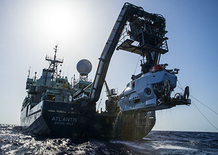 The research vessel Atlantis with the submersible Alvin hanging off its stern. Photo credit: Luis Lamar, Woods Hood Oceanographic Institution. Click to enlarge.