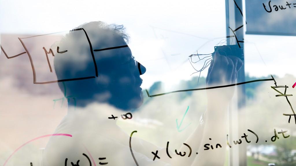 A dreamy double exposure of Alpert Bozkurt and his equations.