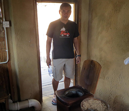 De los Reyes with a composting toilet in Malawi. Photo courtesy of Francis de los Reyes.