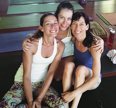 Brown (left) and yoga friends Whitney Homans and Colleen Hohenstein at Samahita Retreat, Koh Samui, Thailand. Photo courtesy of Ashley Brown.