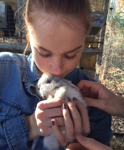 Emily Grace Benefield holds a bunny at the Chatham Rabbit Farm, a small business highlighted by People-First Tourism. Photo courtesy of Elizabeth Benefield.