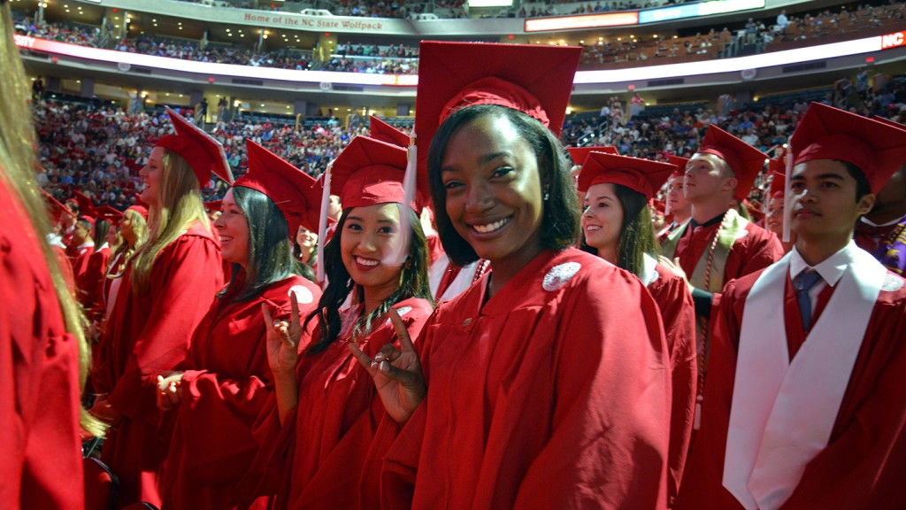A diverse group of NC State students at graduation.