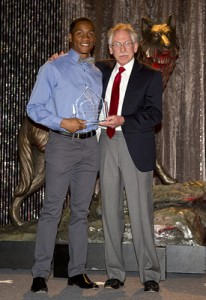 NC State long jumper Jonathan Addison and longtime track and field coach Rollie Geiger.