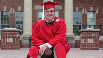 A portrait of Colin White of NC State's College of Natural Resources in his graduation robes.