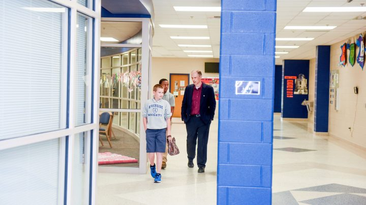 Assistant principal Larry Hodgkins walks the halls of Riverside Middle School.