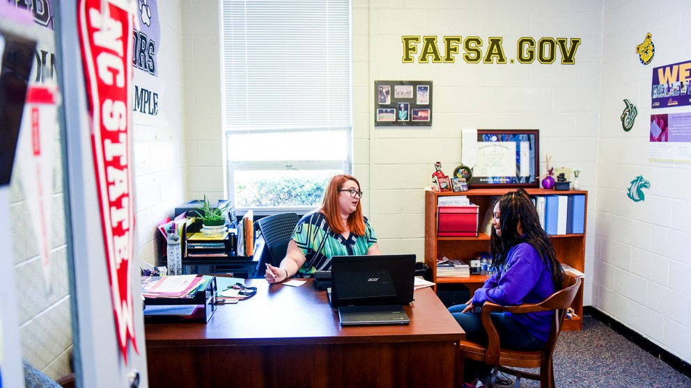 Dani Lechner advises a student in her office at South Creek High School in Martin County.