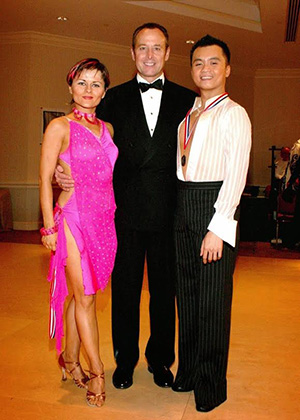 Scott Vu with his partner, Linara Axanova, and coach, Wayne Crowder, after dancing championship latin at Carolina Fall Classic ballroom competition. Photo courtesy of Vu.