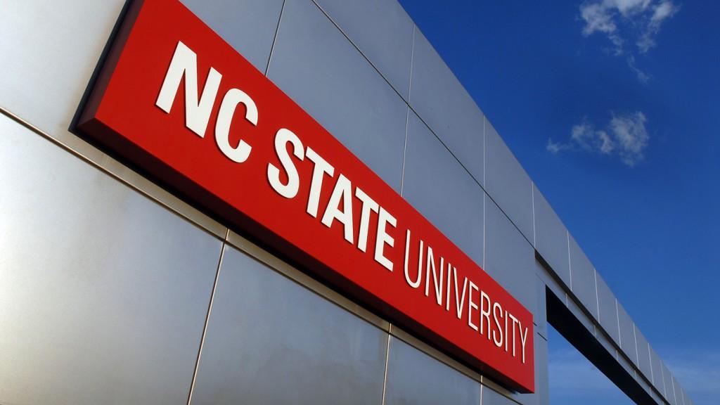 NC State University sign on metal gateway.