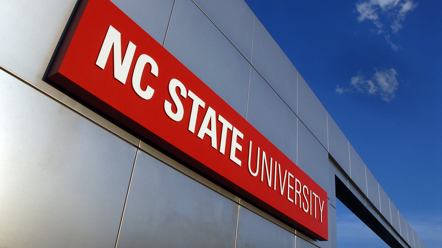 NC State University sign on metal gateway.
