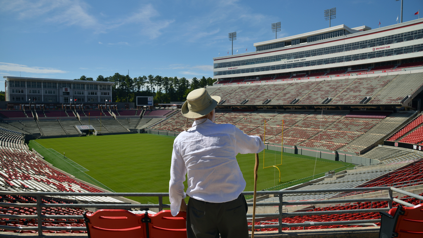 Charles Kahn views the field at Carter-Finley Stadium from the stands.