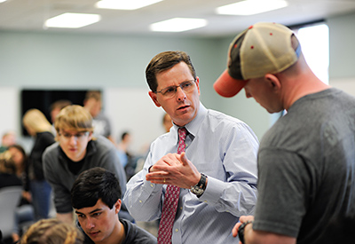 Jeff Joines' hands-on teaching methods are popular with students in NC State's demanding textile engineering program. Photos by Marc Hall.