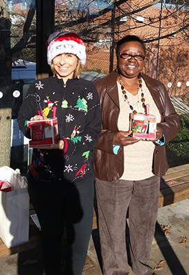 Staff members deliver holiday mugs for Wolfline drivers.
