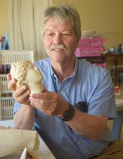NC State Professor of History Tom Parker examines a statue of Aphrodite, discovered during a 2016 excavation in Petra, Jordan. Photo courtesy of Tom Parker.